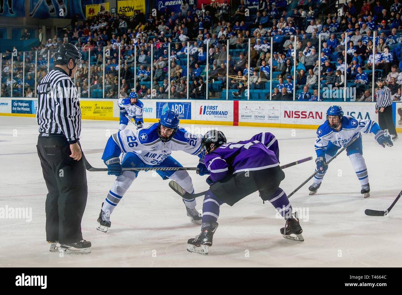 U.S. Air Force Academy – Air Force's Erich Jaeger and Joe Tyran focus on the referee shortly before a faceoff during a game against Holy Cross on March 2, 2019 at the Cadet Ice Arena. Air Force defeated Holy Cross 4-2. - Stock Image