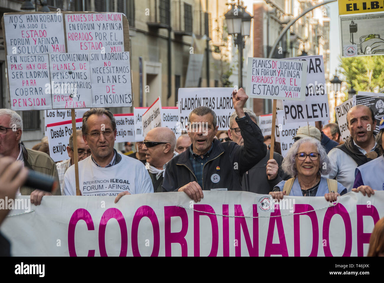 Protesters are seen holding placards and a banner while chanting slogans during the demonstration. Demonstration to defend the systemic public pension in Madrid by the CCOO coordination of pensioners that calls on the Government to ensure the presentation in this term of an initiative to repeal the pension reform of 2013, which must be legally validated in the face of elections this month of April 2019, within the framework of broad agreements in the political and social sphere. This initiative is a prior agreement of the social partners (trade unions and employers), culminating the process of Stock Photo