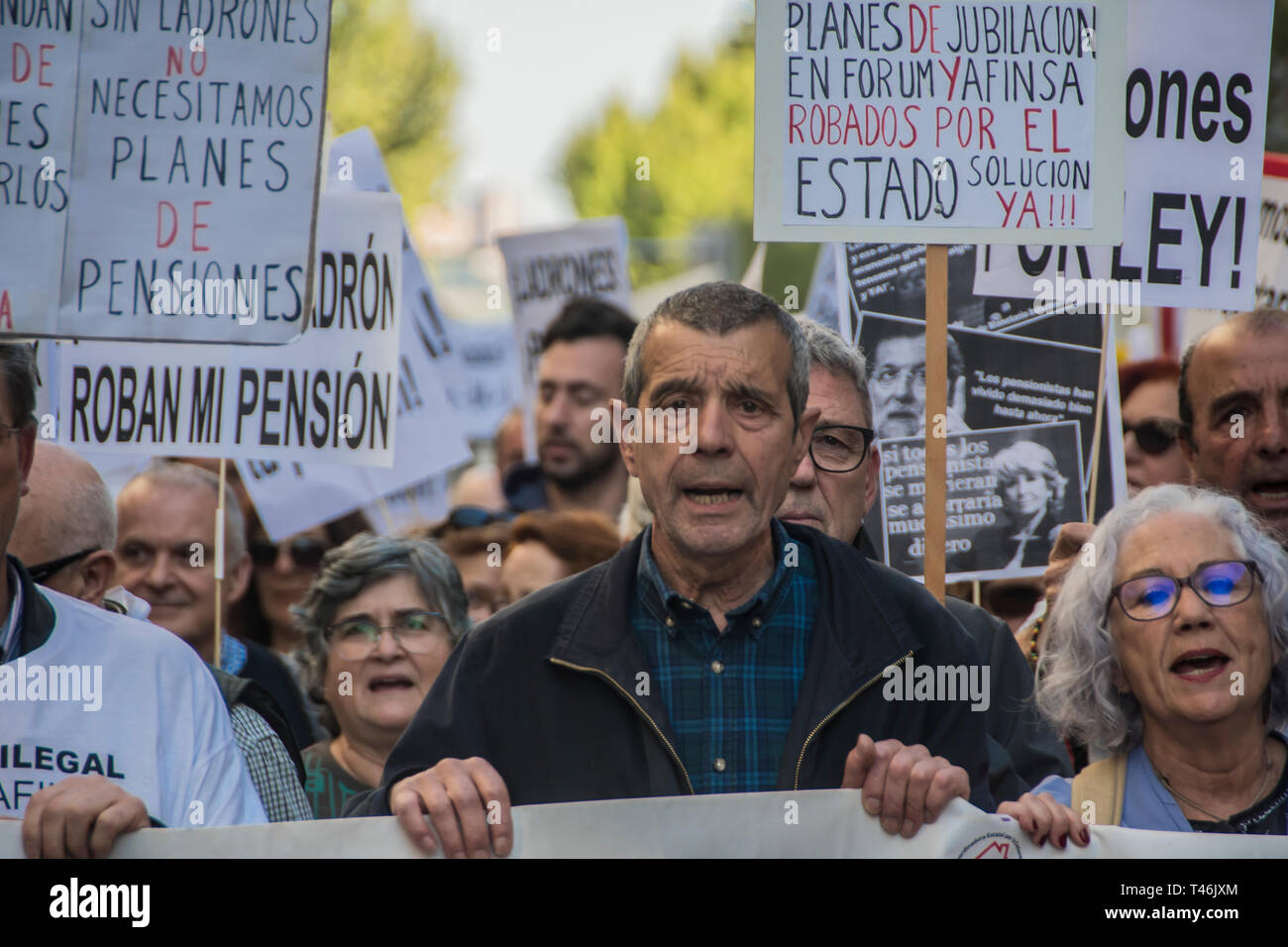 Protesters are seen holding placards while chanting slogans during the demonstration. Demonstration to defend the systemic public pension in Madrid by the CCOO coordination of pensioners that calls on the Government to ensure the presentation in this term of an initiative to repeal the pension reform of 2013, which must be legally validated in the face of elections this month of April 2019, within the framework of broad agreements in the political and social sphere. This initiative is a prior agreement of the social partners (trade unions and employers), culminating the process of consultation Stock Photo