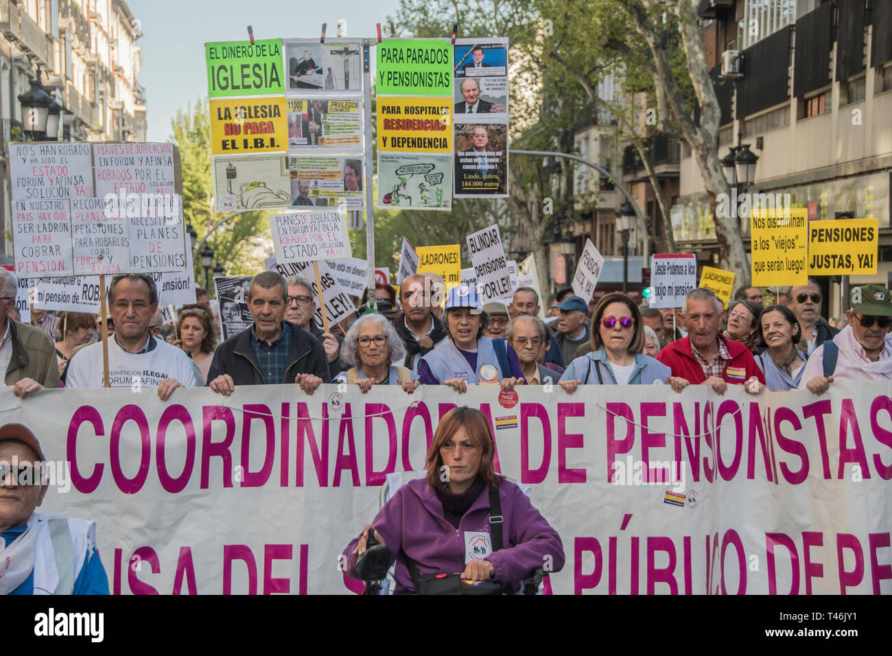 Protesters are seen holding placards and a banner during the demonstration. Demonstration to defend the systemic public pension in Madrid by the CCOO coordination of pensioners that calls on the Government to ensure the presentation in this term of an initiative to repeal the pension reform of 2013, which must be legally validated in the face of elections this month of April 2019, within the framework of broad agreements in the political and social sphere. This initiative is a prior agreement of the social partners (trade unions and employers), culminating the process of consultation with the  Stock Photo