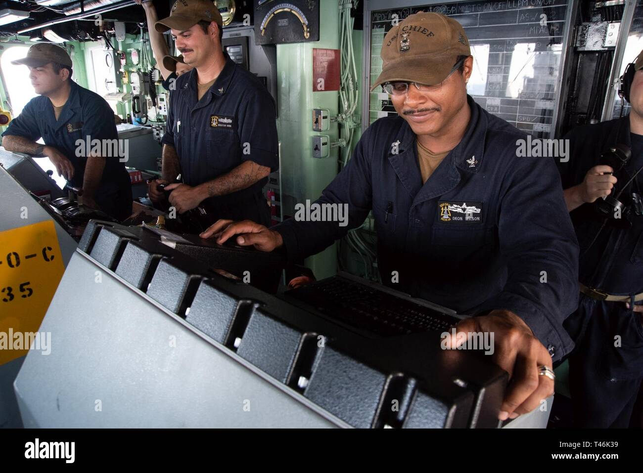 SOUTH CHINA SEA (March 16, 2019) Mineman 2nd Class Deon Wilson, from Albany, New York, monitors radar readings aboard the Avenger class mine countermeasures ship USS Chief (MCM 14) during a replenishment-at-sea with USNS Guadalupe (T-AO 200). Chief, part of Mine Countermeasure Squadron 7, is operating in the Indo-Pacific region to enhance interoperability with partners and serve as a ready-response platform for contingency operations. - Stock Image