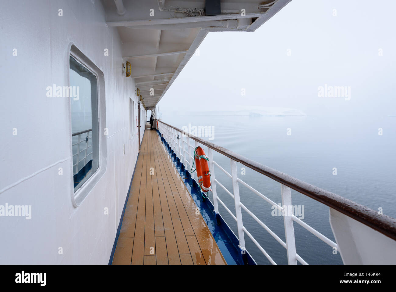 View of foggy shoreline from outside deck of cruise ship, Antarctica Stock Photo