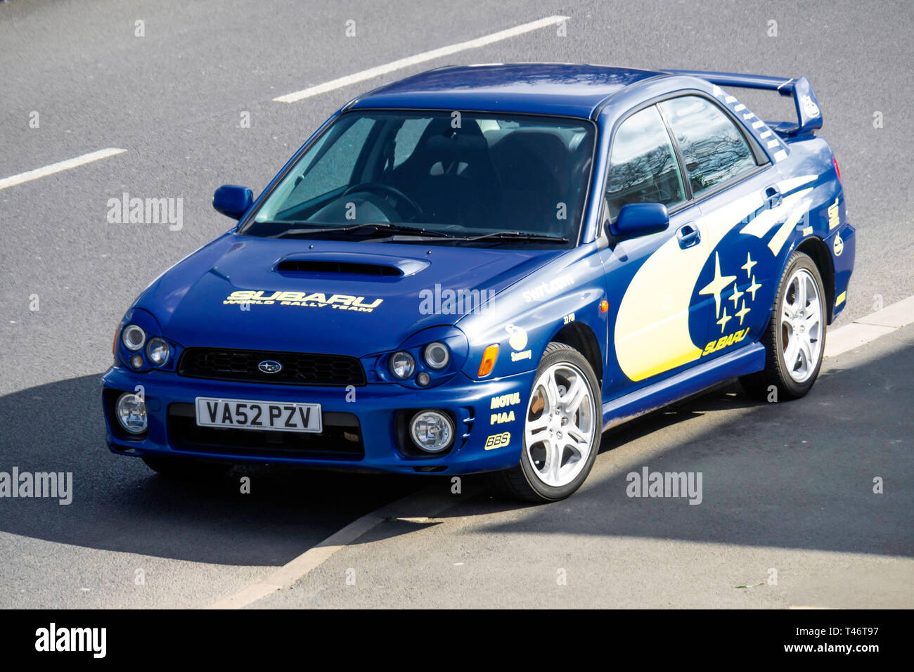A classic 2012 Blue and Yellow Subaru WRX sports car in  North Yorkshire England UK Stock Photo