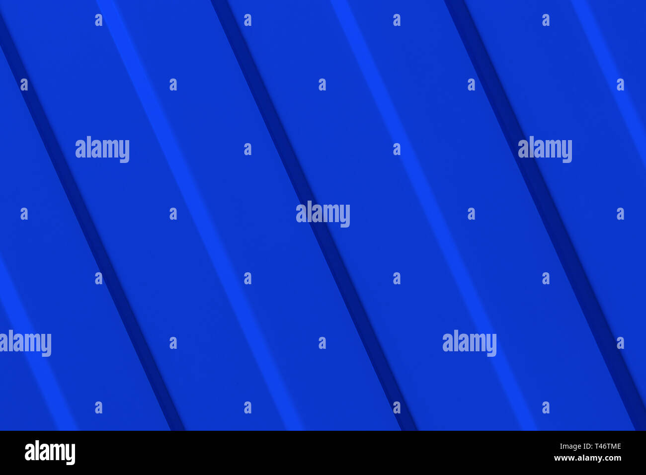 The surface of the metal profiled panel in blue close-up. Diagonal guides. - Stock Image