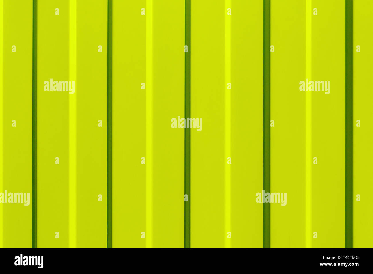 The surface of the metal profiled panel yellow close-up. Background. - Stock Image