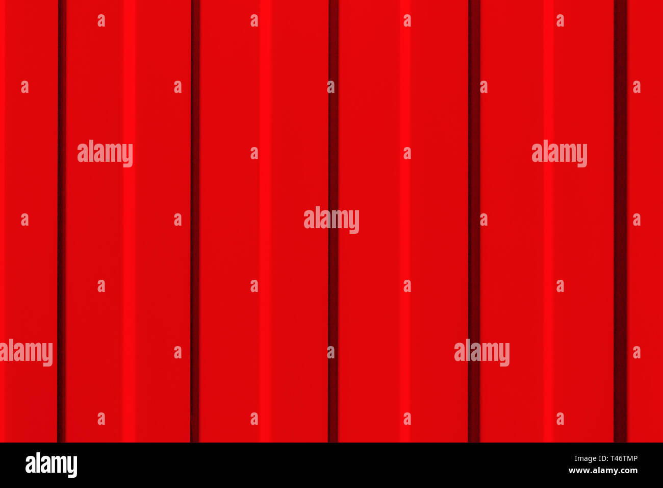 The surface of the metal profiled panel in red close-up. - Stock Image