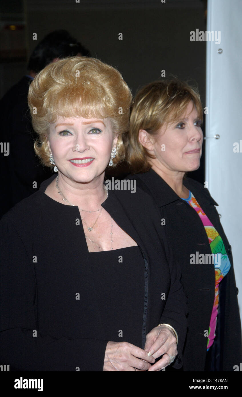 LOS ANGELES, CA. August 19, 2003: Actress DEBBIE REYNOLDS & daughter actress CARRIE FISHER at the 2nd Annual Runway for Life celebrity fashion show benefitting the St. Jude's Children's Research Hospital and celebrating the DVD release of Chicago. - Stock Image