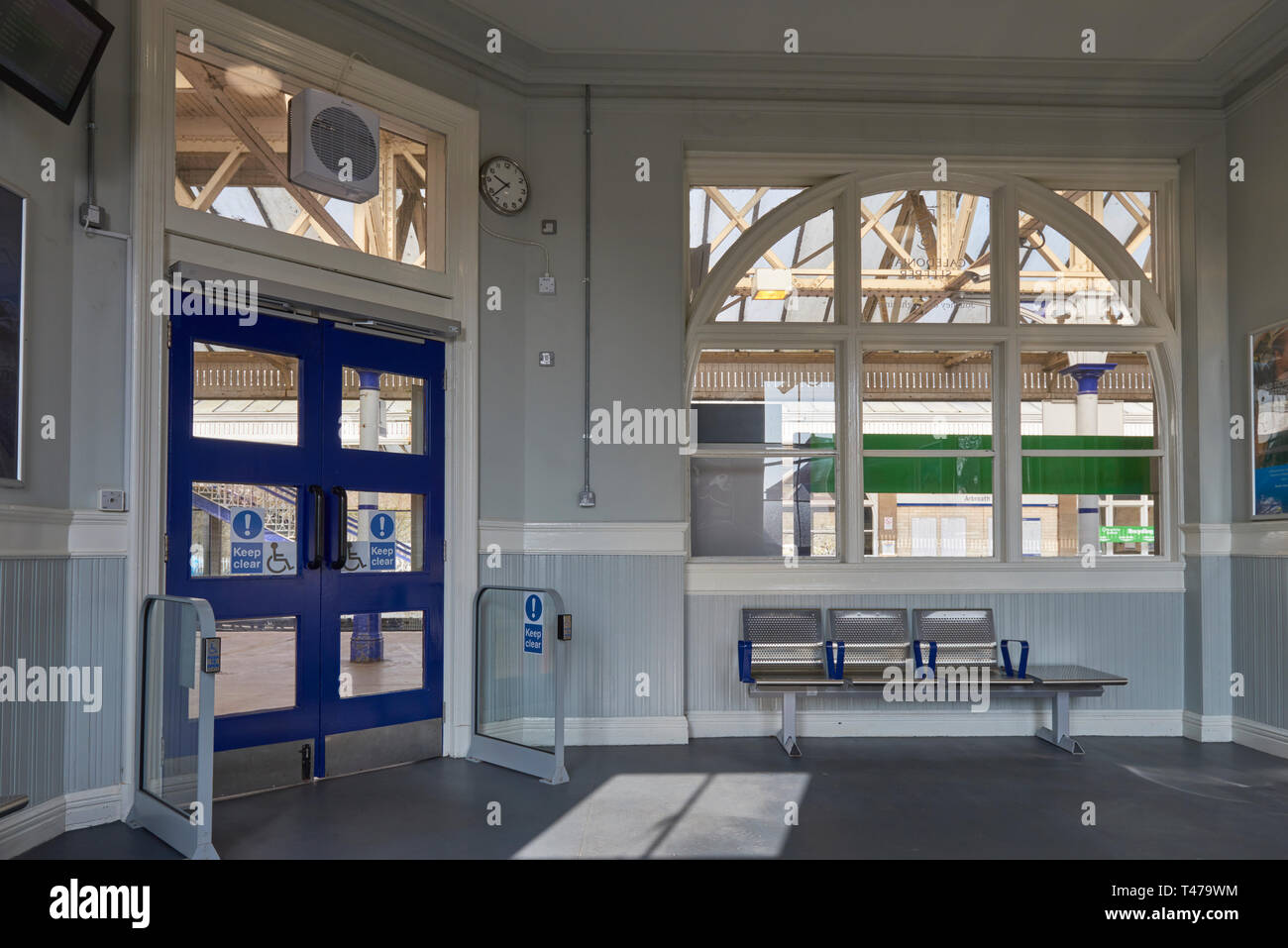 The Waiting Room at Arbroath Station on one Spring Day in April, with its stainless steel seating and disability friendly automatic doors. Angus, Scot - Stock Image
