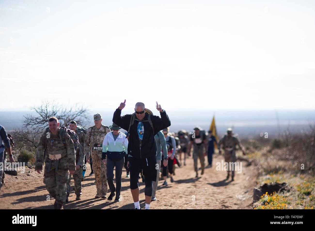 Maj. Gen. Michael Thompson, adjutant general for Oklahoma, marches alongside Oklahoma National Guard members from around the state, joining more than 8,600 people from around the world during the 30th annual Bataan Memorial Death March, Sunday. The March, established in 1989, honors the heroic service members who defended the Philippine Islands during World War II, sacrificing their freedom, health and, in many cases, their lives. - Stock Image