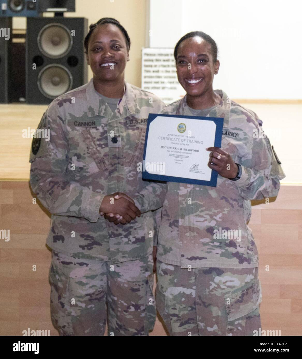 U.S. Army Lt. Col. LaKetter Cannon, Assistant Chief of Staff G1 1st Theater Sustainment, left, poses with Master Sgt. Shakka Bradford, HHC supply noncommissioned officer in charge, 335th Signal Command (Theater) (Provisional), following the Equal Opportunity Leaders Course graduation ceremony at Camp Arifjan, Kuwait, March 17, 2019. - Stock Image