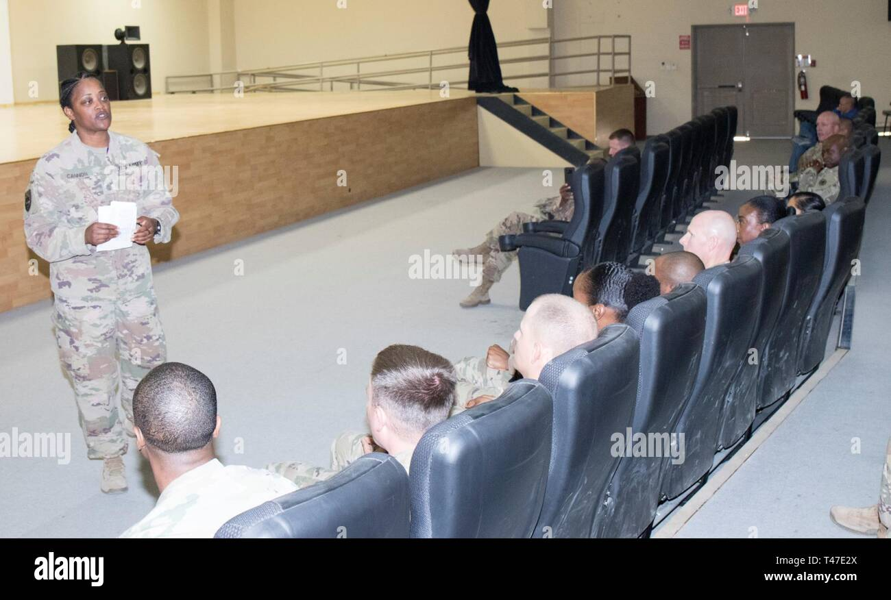 U.S. Army Lt. Col. LaKetter Cannon, Assistant Chief of Staff G1 1st Theater Sustainment Command, serves as the guest speaker during the Equal Opportunity Leaders Course 19-06 graduation at Camp Arifjan, Kuwait, March 17, 2019. - Stock Image