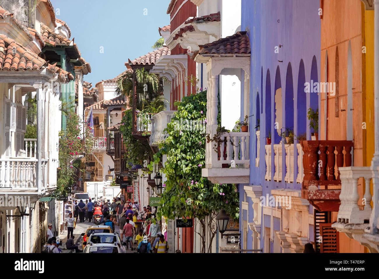 Cartagena Colombia Old Walled City Center centre Centro historic colonial architecture narrow street balconies busy - Stock Image
