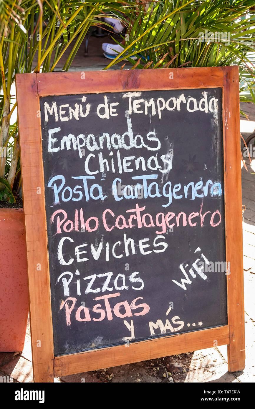 Cartagena Colombia Old Walled City Center centre Centro Plaza Santo Domingo restaurant chalkboard menu posta cartagenera pizzas pastas wifi seasonal m - Stock Image
