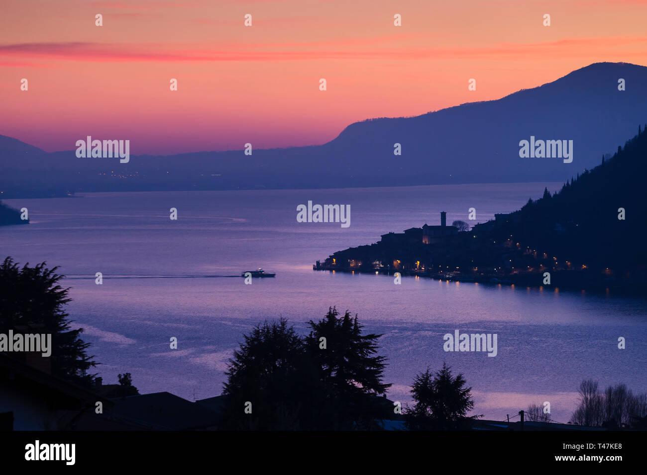 Lake Iseo with Peschiera Maraglio at dusk, Lombardy, Italy Stock Photo