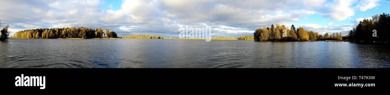 Panorama image of finnish landscape with lake and forrest - Stock Image