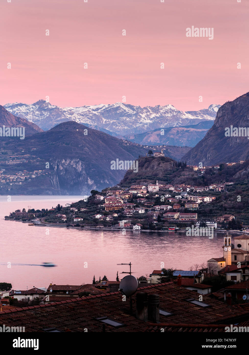 Lake Iseo at dawn, seen from Sale Marasino to the north and the Alps, Lombardy, Italy Stock Photo