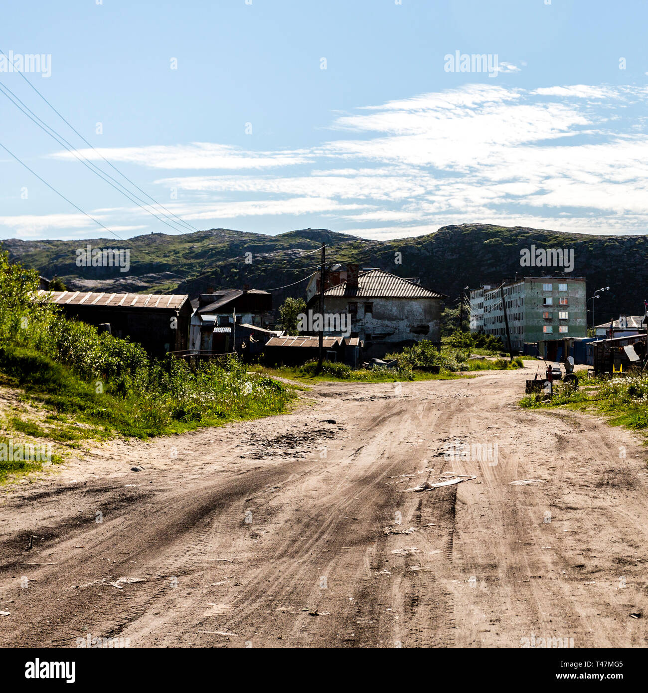 Street in rural locality village Teriberka in Kolsky District of Murmansk Oblast, Russia - Stock Image