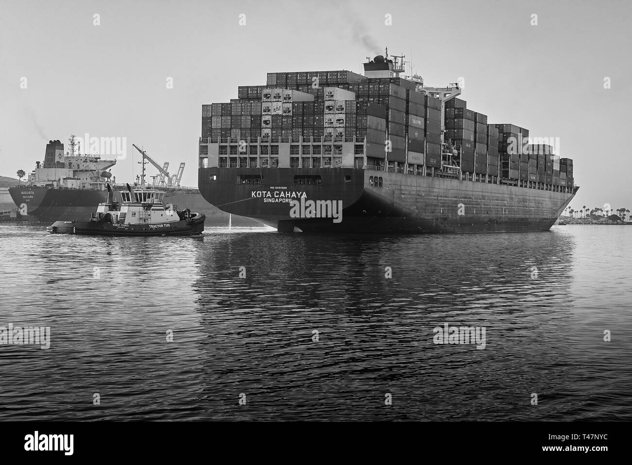 Container Ship, KOTA CAHAYA, Underway Through The Narrow Los Angeles Main Channel As She Departs The Port Of Los Angeles, California, USA. - Stock Image