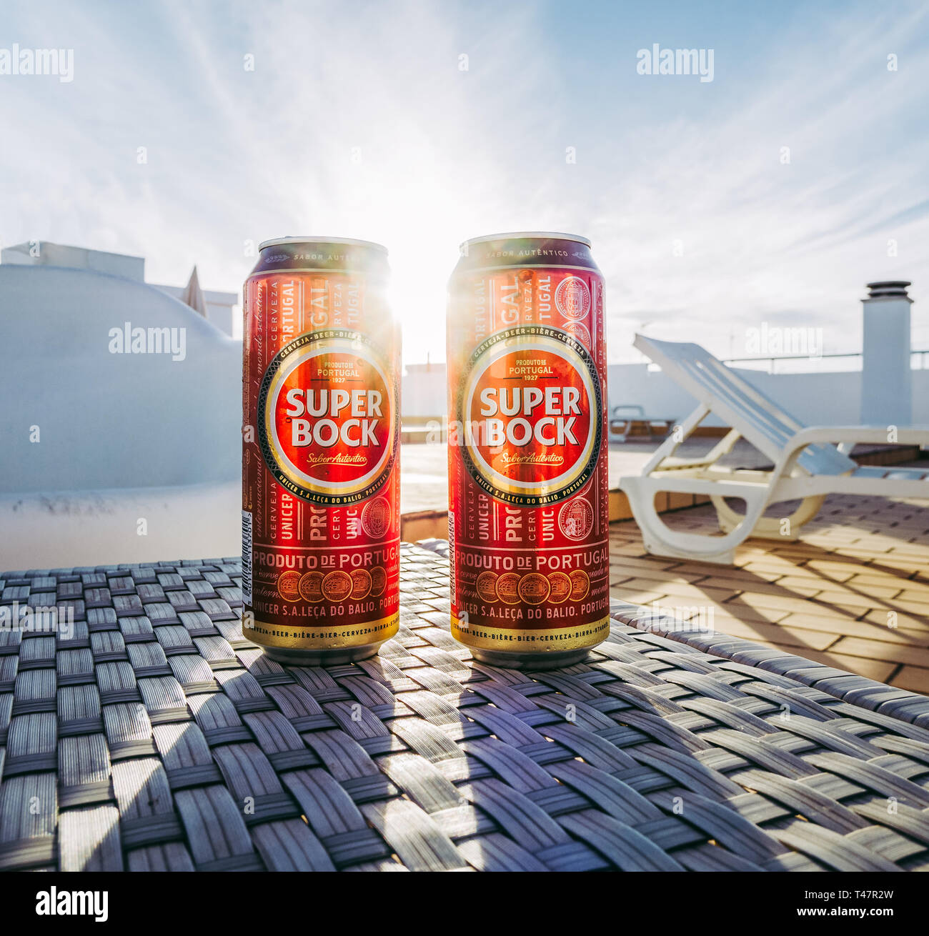 Lisbon, Portugal - August 1, 2017: Two Super Bock beer cans with sun shining between them. - Stock Image