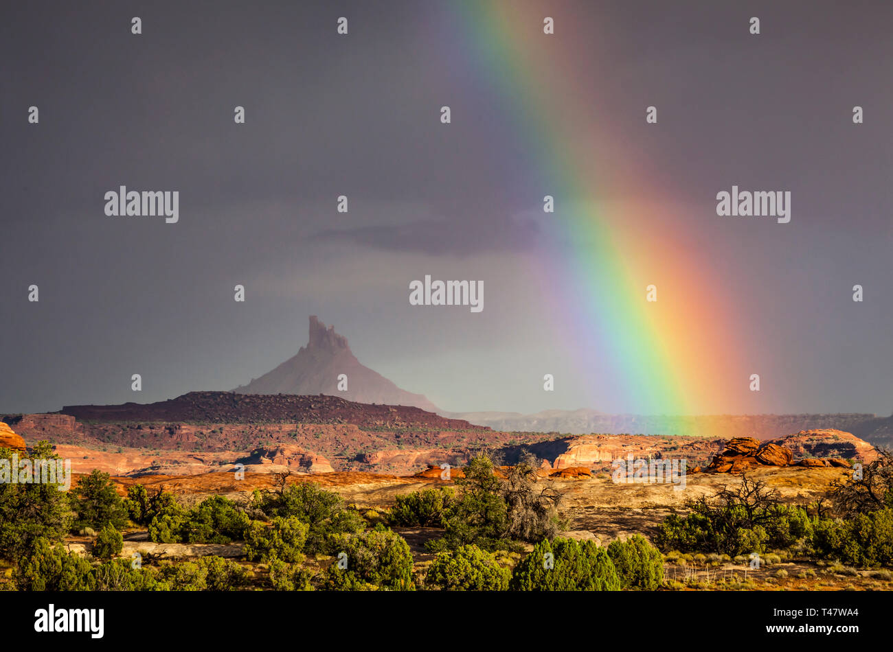 A rainbow over South Six-Shooter Peak in South Eastern Utah as seen from Canyonland National Park during a rain storm, USA. Stock Photo