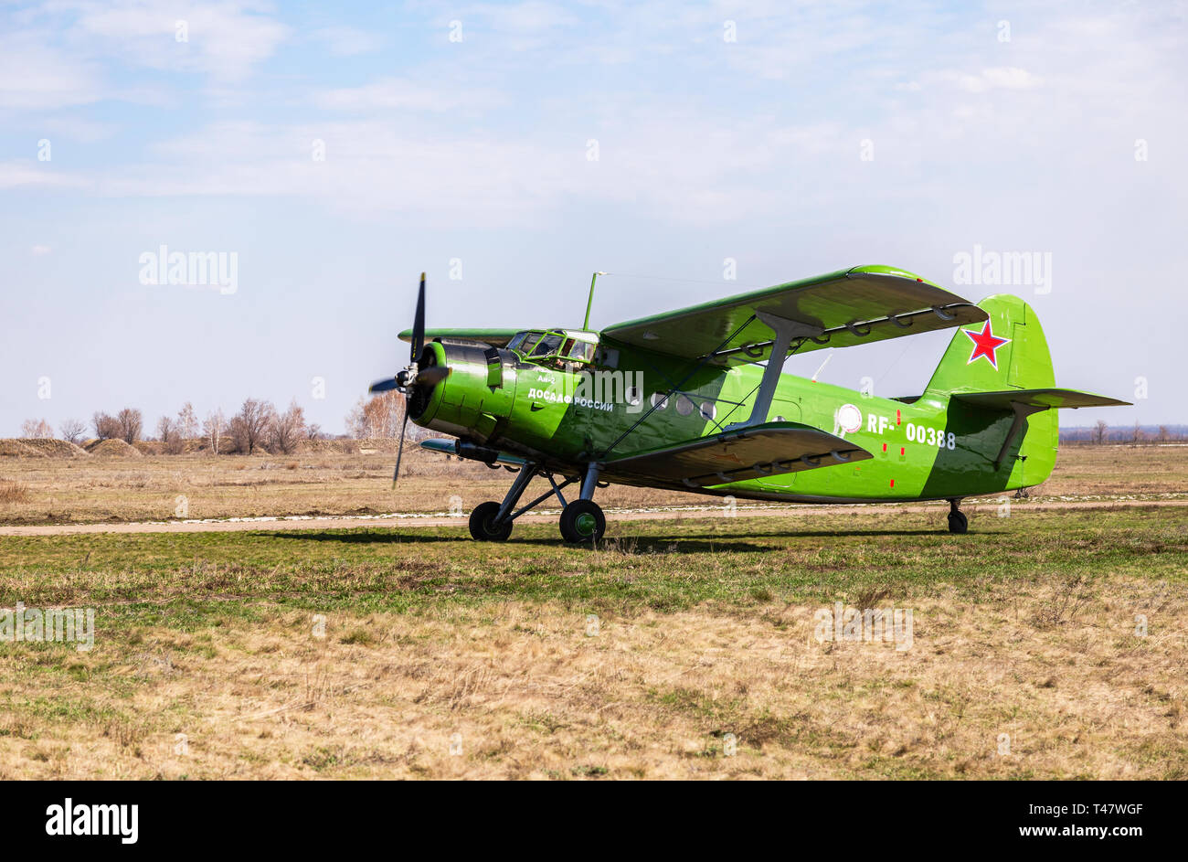 Samara, Russia - April 13, 2019: The Antonov An-2 a Soviet mass-produced single-engine biplane at an field aerodrome in summertime - Stock Image