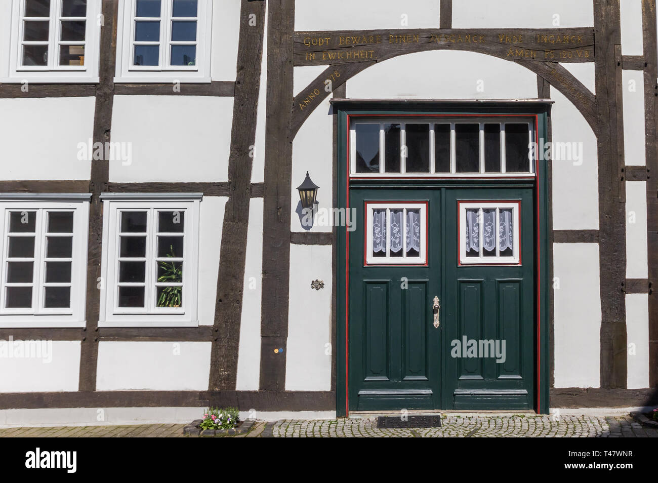 Green door in a half timbered house in Rheda, Germany - Stock Image
