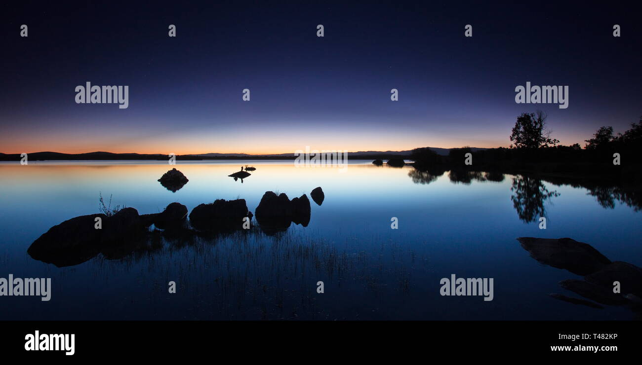 Blue hour in the Villardeciervos reservoir (Zamora, Spain). Stock Photo