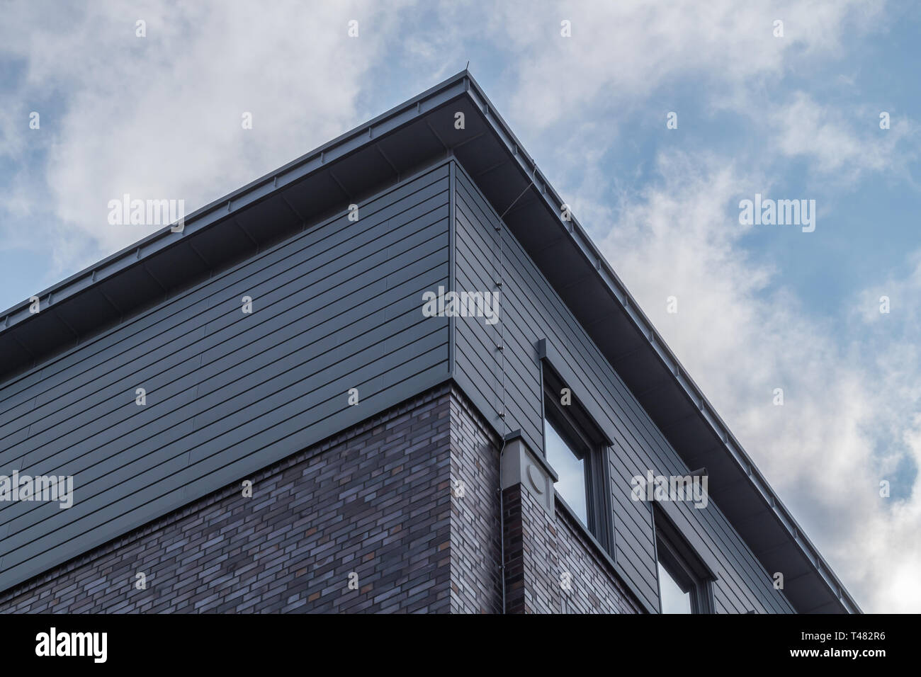 Looking up to the corner of modern office building. Urban architecture in the city. - Stock Image