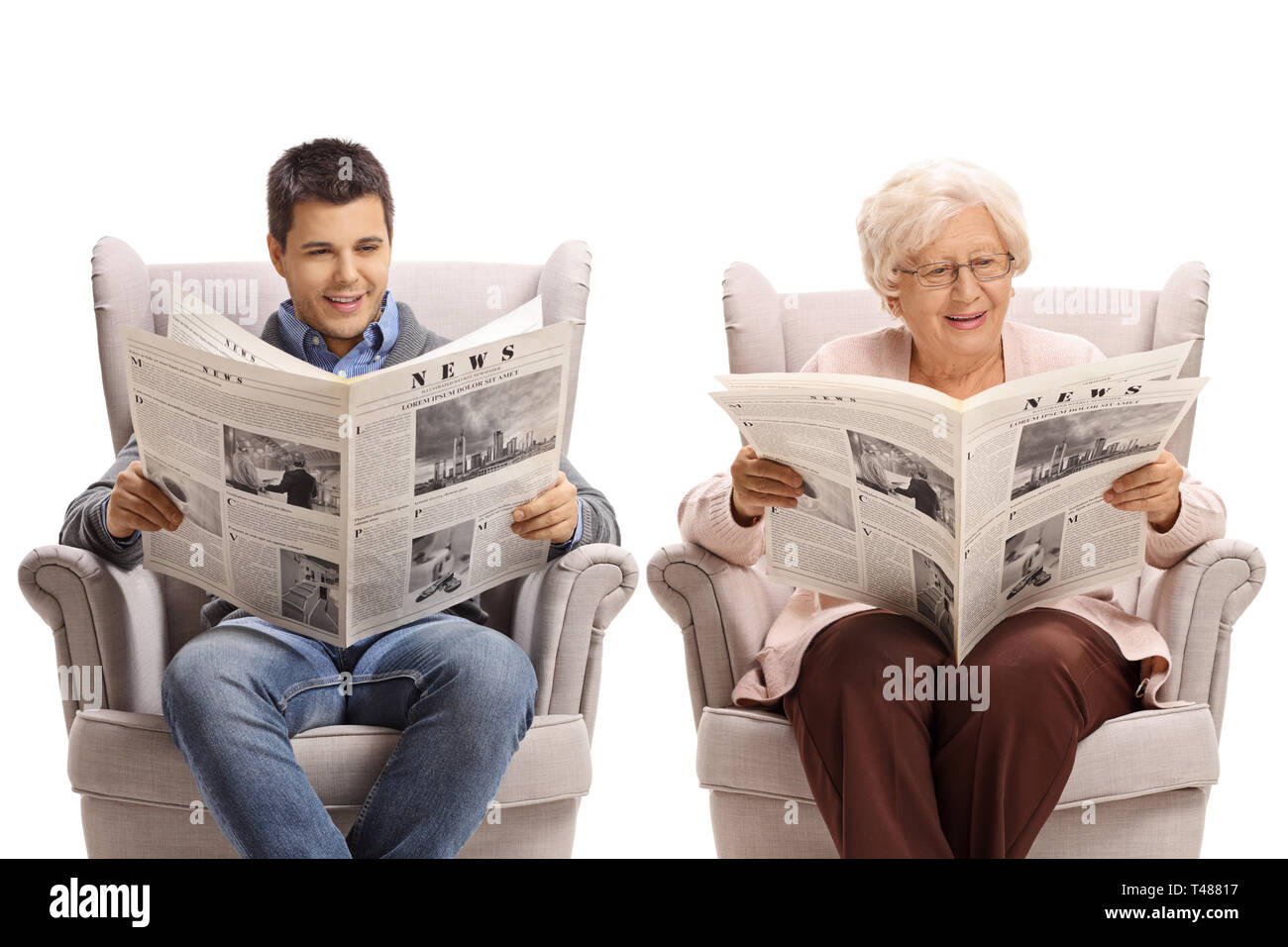 Young man and a senior woman sitting in armchairs and reading newspapers isolated on white background - Stock Image
