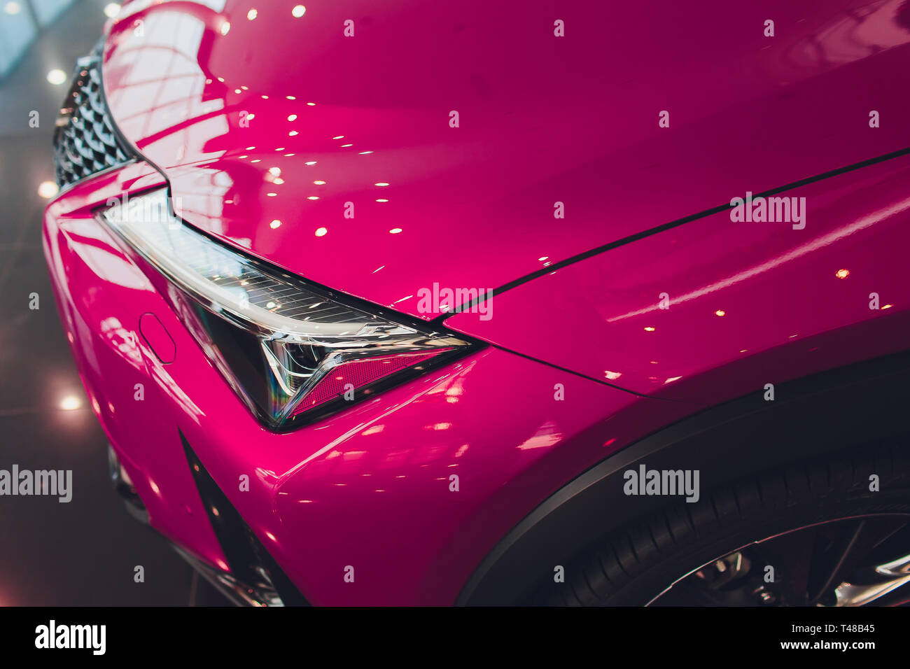 Close Up Shot Headlight In Luxury Pink Car Background Modern And