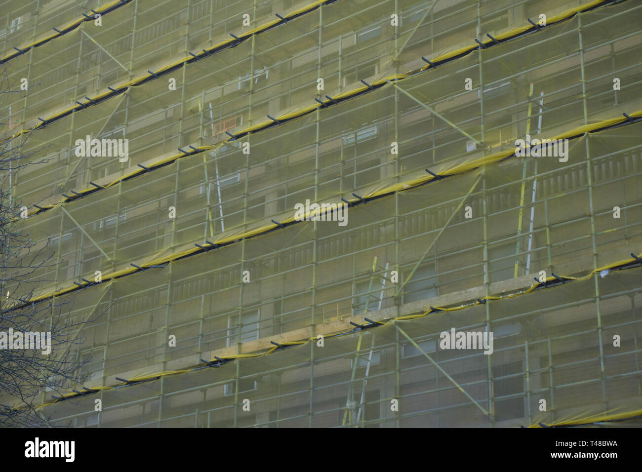 Full frame close up of tarpaulin covered scaffolding - Stock Image