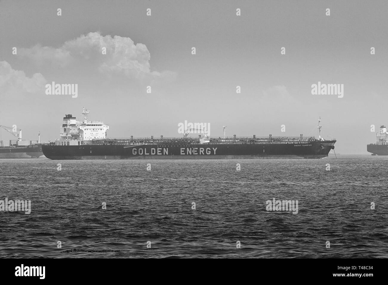 Black And White Photo Of The GOLDEN ENERGY Supertanker, (Crude Oil Tanker), ENERGY CHAMPION, Anchored In The Port Of Long Beach, California, USA. - Stock Image