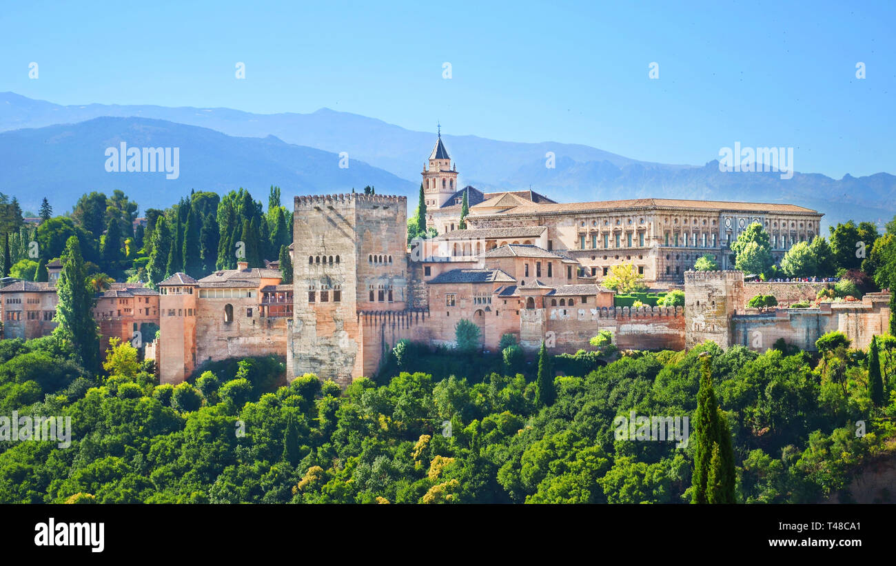 Beautiful Alhambra Palace complex in Spanish Granada on a sunny day captured on 16:9 photography. The amazing fortress and popular tourist spot. Stock Photo