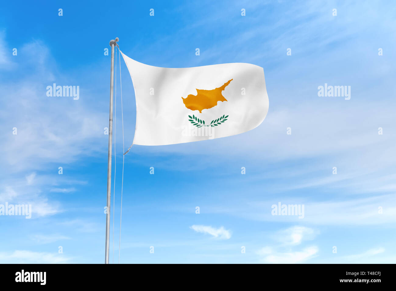 Cyprus flag blowing in the wind over nice blue sky background - Stock Image