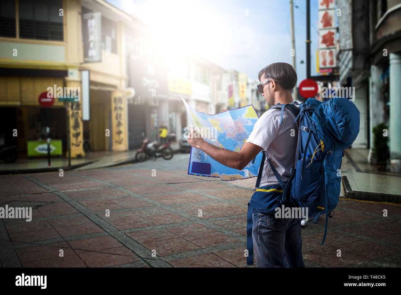 Asia man reading map on street in the city. Stock Photo