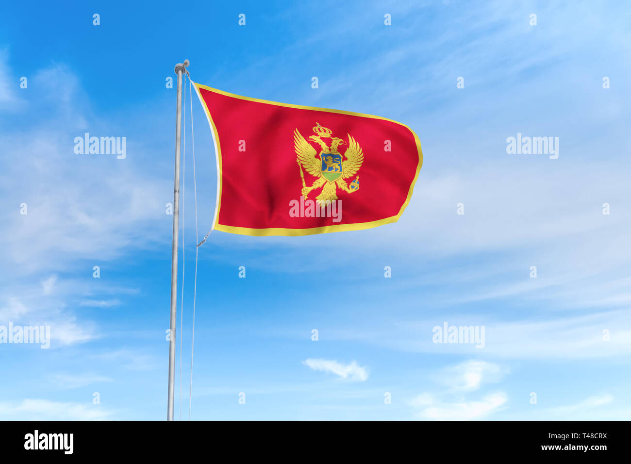 Montenegro flag blowing in the wind over nice blue sky background Stock Photo