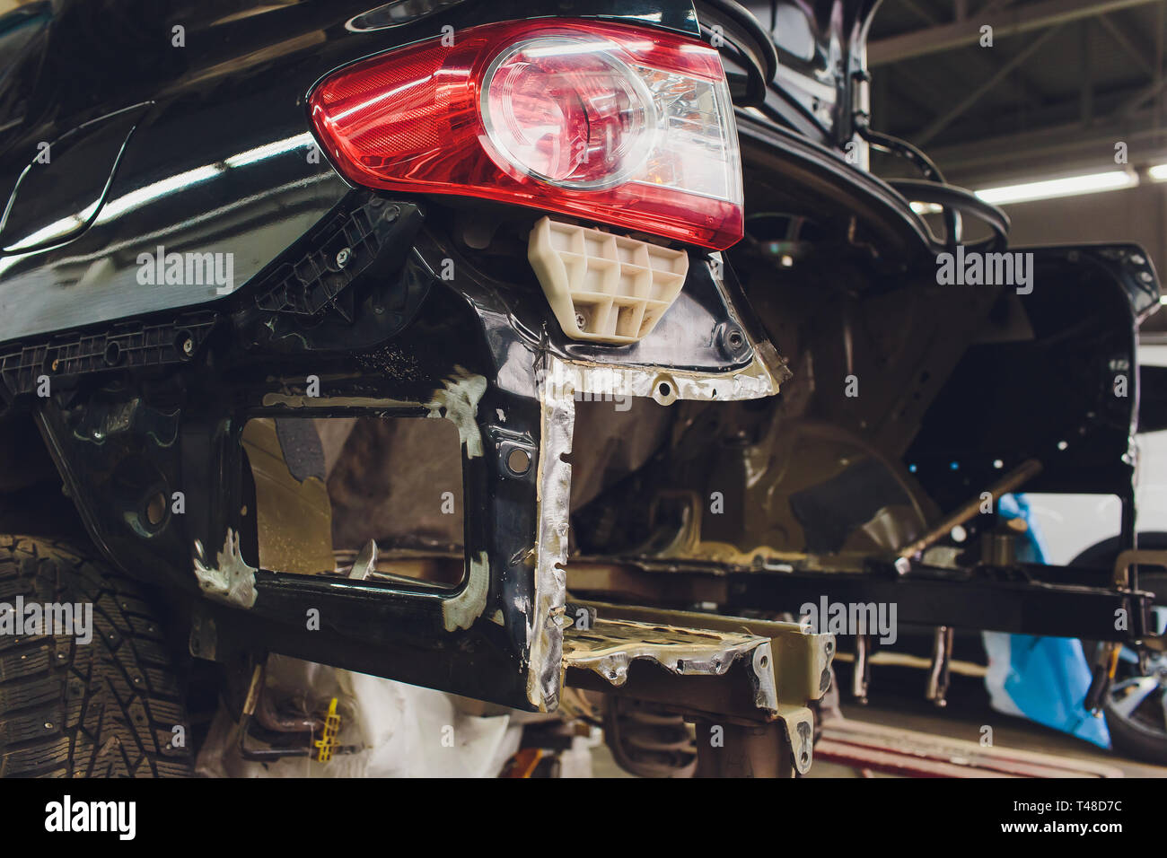 Tuning the car in a sedan body with three layers of noise insulation of the trunk. Audio and vibration isolation. Soft material. Dismantled car Stock Photo
