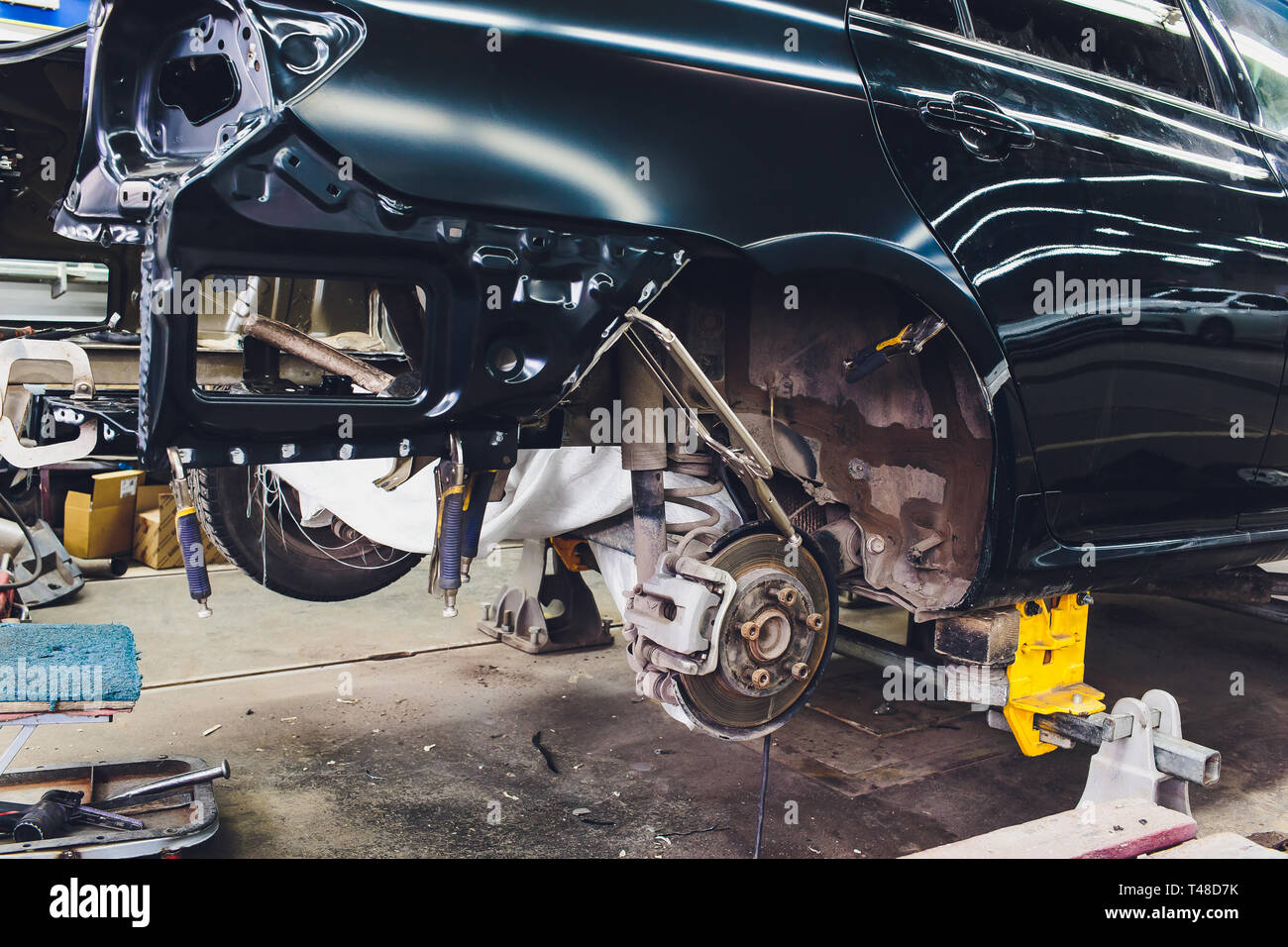 Tuning the car in a sedan body with three layers of noise insulation of the trunk. Audio and vibration isolation. Soft material. Dismantled car - Stock Image