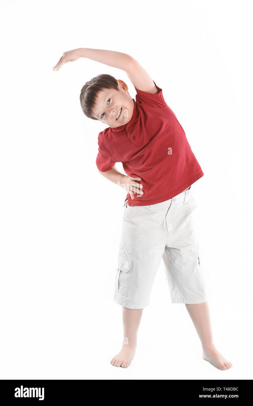 little boy performs an exercise to stretch the muscles.isolated on white. - Stock Image