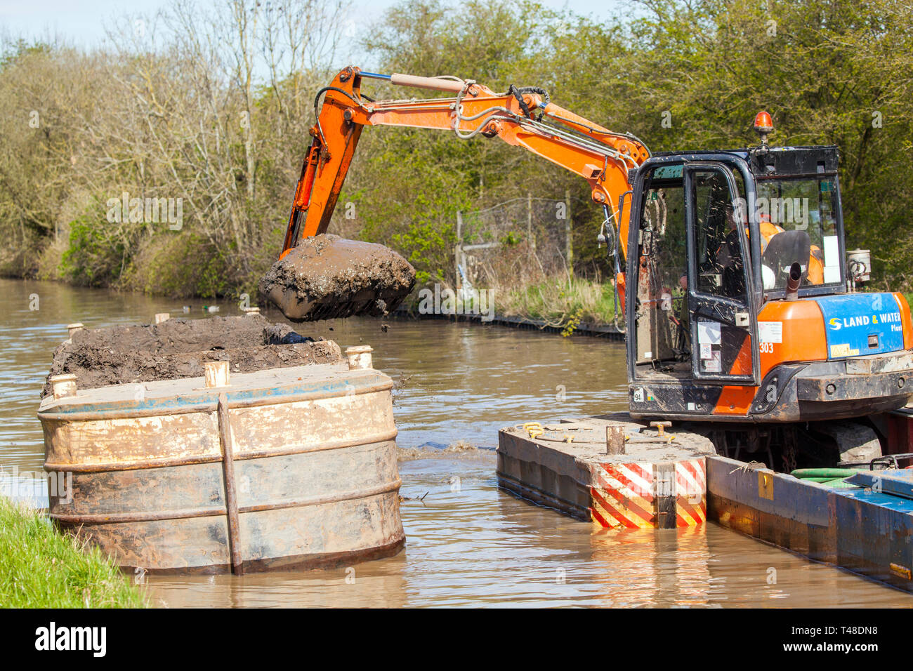 Maintenance repair work and dredging of the Macclesfield canal  being carried out at Buglawton Cheshire England UK Stock Photo