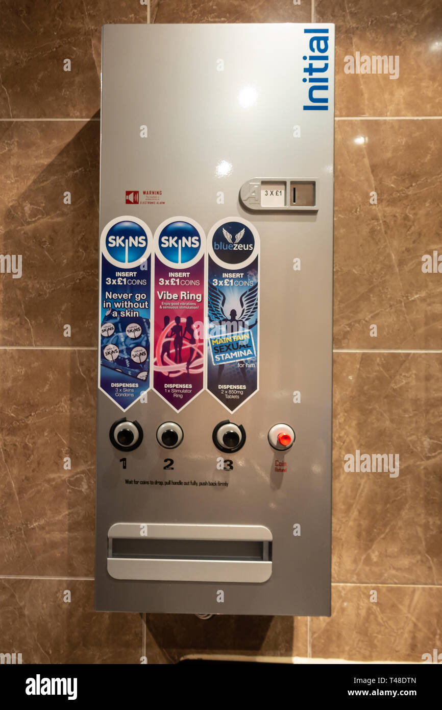A condom vending machine on a wall in a gentlemen's public toilets to allow easy purchase of contraception. Stock Photo