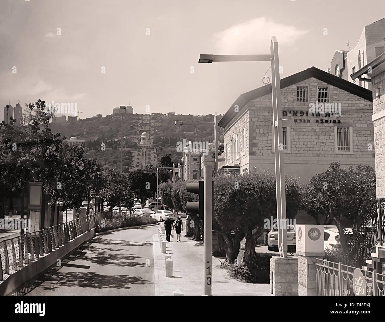 HAIFA, ISRAEL - SEPTEMBER 18, 2017: On the sreet of Haifa and view of Bahai gardens - Stock Image