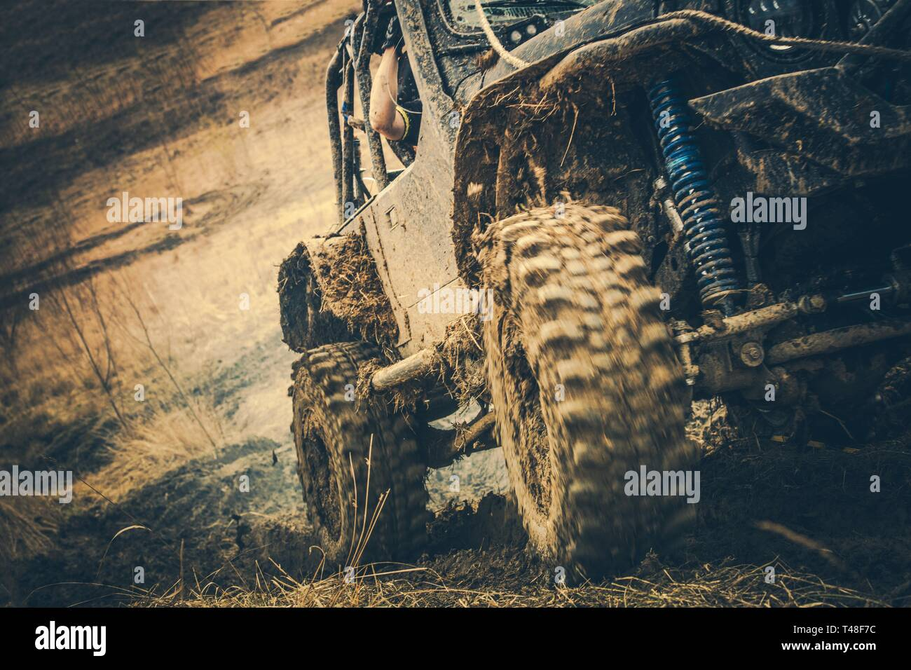 Dirty Off Road Trail Drive. Powerful Sport Utility Vehicle in the Mud. Motorsport Theme. - Stock Image