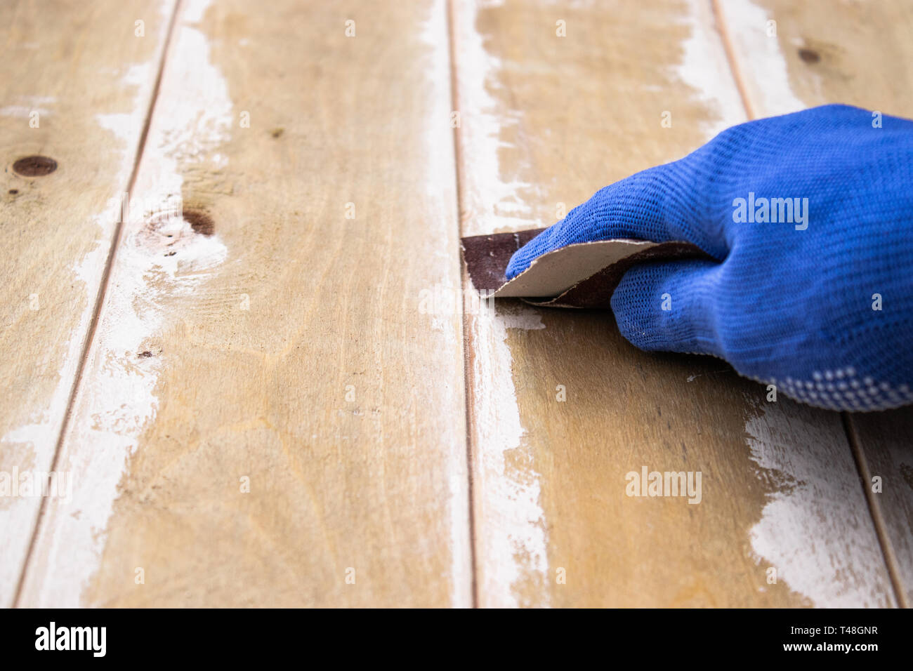 emery paper rubs the board. Grinding boards before painting. Preparation for painting. - Stock Image