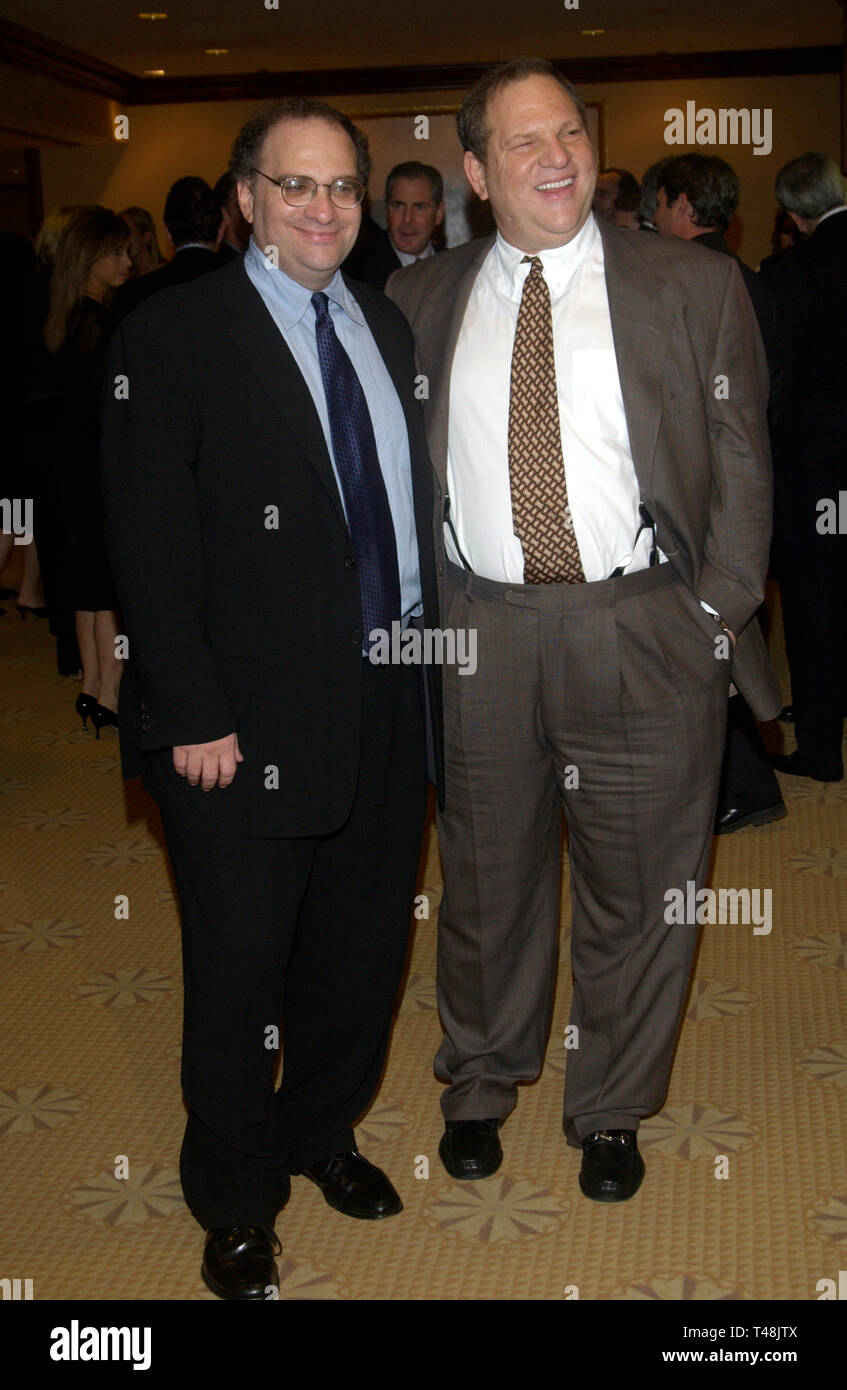 LOS ANGELES, CA. September 25, 2003: Miramax founders BOB (left) & HARVEY WEINSTEIN at the National Multiple Sclerosis Society's 29th Annual Dinner of Champions where they were honored. - Stock Image