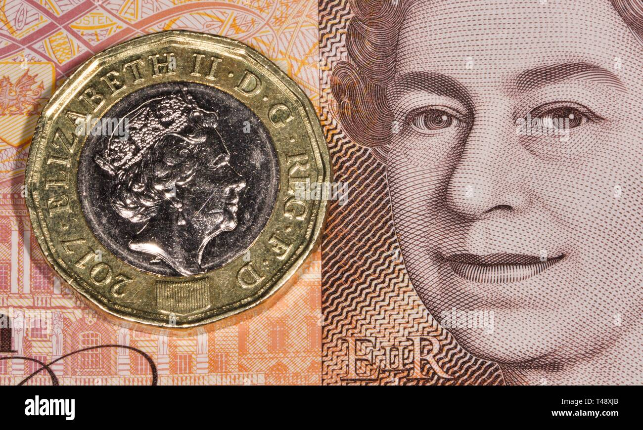 One pound coin on the new £10 pound polymer banknote - Stock Image
