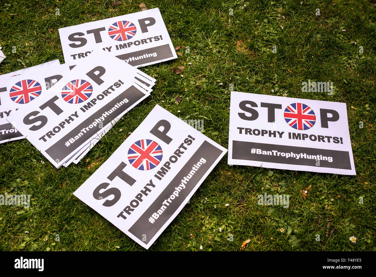 Placards at a stop trophy hunting and ivory trade protest rally, London, UK. Stop trophy imports, ban trophy hunting placard - Stock Image