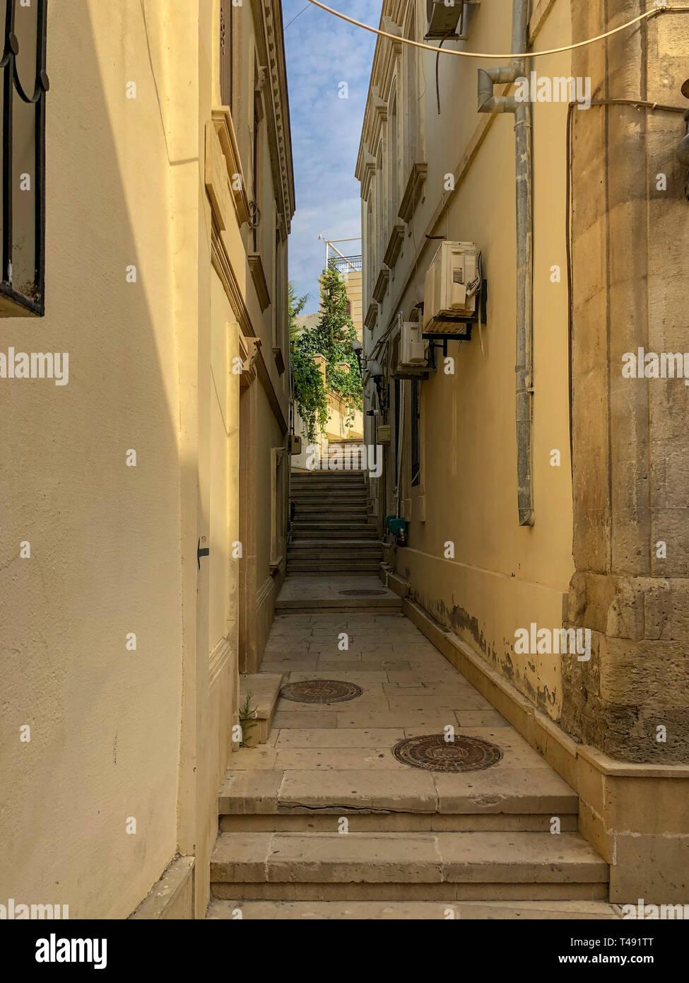 Narrow winding staircase in the old city of Baku, Azerbaijan. - Stock Image