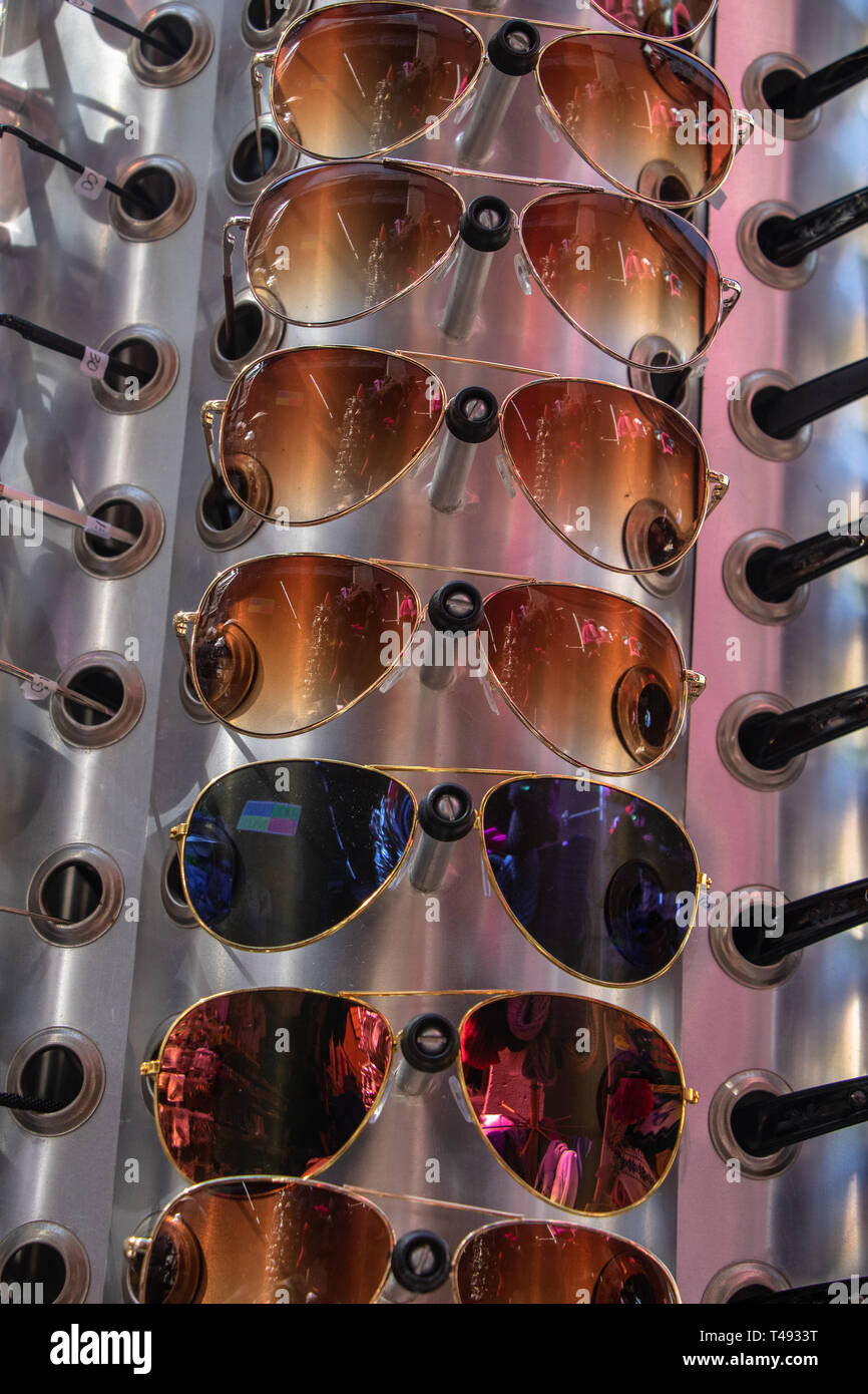 Display of sunglasses in a market in Mexico - Stock Image
