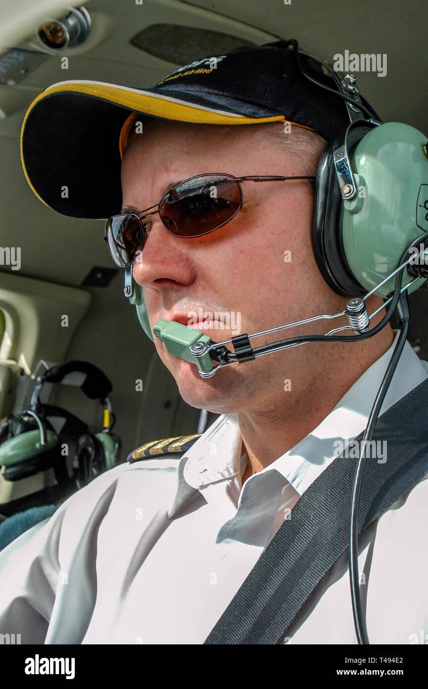 2e1c4c9efc Portrait view of a young male commercial pilot wearing Dave Clark headphones